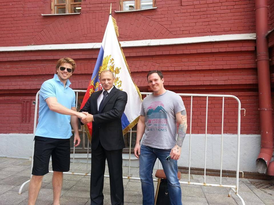 Shaking hands with Putin at Kremlin